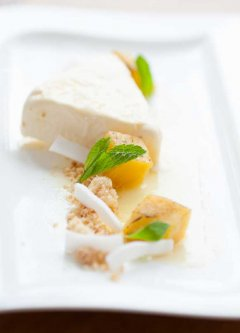 Soft focus image of a cheesecake dessert on a white plate