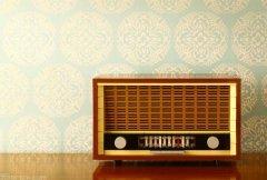 Retro radio on wooden sideboard