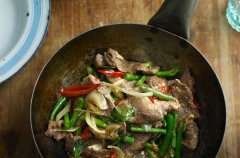 Close up of stir fry pork and vegetables in a wok